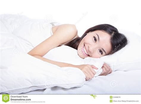 lying on the bed woman smile face close up lying on the bed royalty free