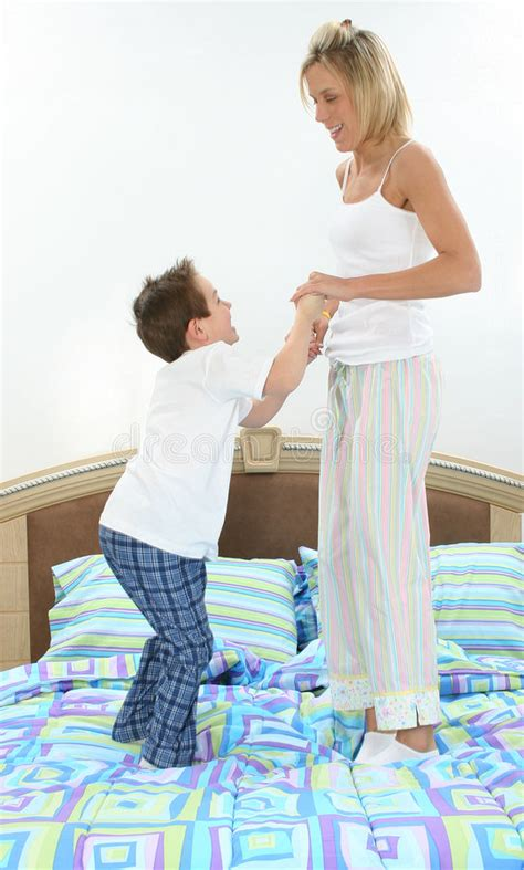 mom son bed mother and son playing in bed stock photos image 499293