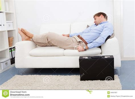 a man and a couch tired young man on couch stock image image of modern