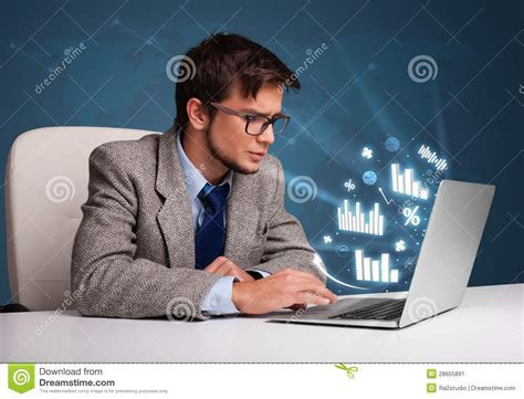 Man Sitting At A Desk Young Man Sitting At Desk And Typing On Laptop With