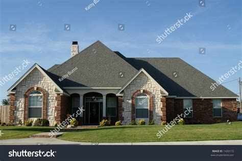 Brickhouse Cottages by New Cottage Style Brick Home Stock Photo 1420172