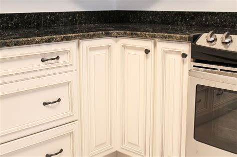 kitchen cabinets door handles white cabinetry with dark hardware knob on lazy susan