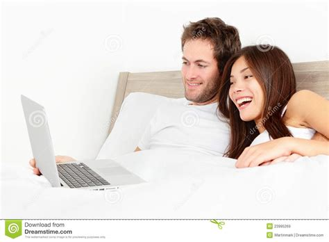 what are chinese women like in bed couple with laptop in bed royalty free stock images