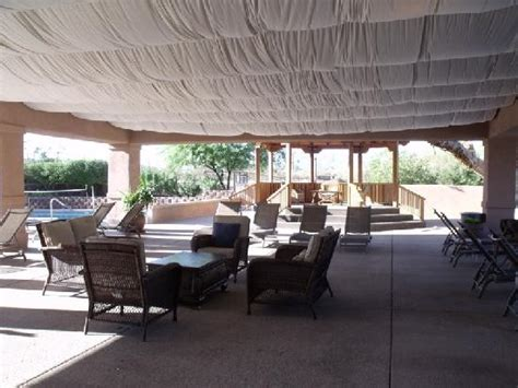 swim pool with covered patio in background picture of