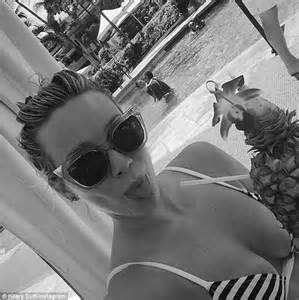 hair sticking out of swimsuit hilary duff channels lizzie mcguire with her new blonde