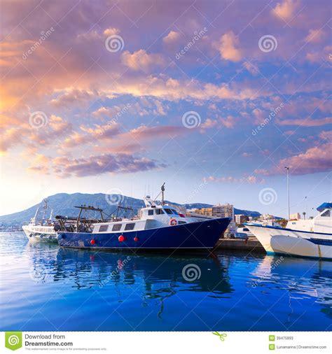 Denia Etnic denia port fisherboats montgo mountain in alicante stock