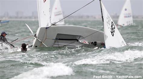 catamaran vs monohull capsize capsizing a sailboat laser sailboat capsized things i