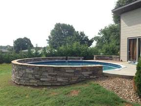 above ground pool connected to backyard patio above