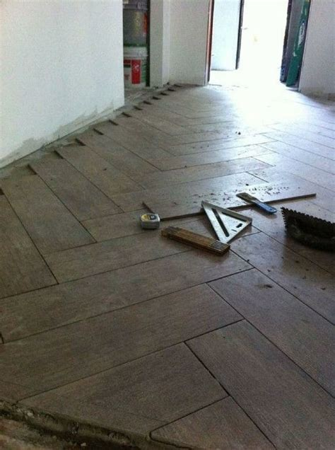 install a herringbone pattern with quot wood quot tile diy decor and home improvement pinterest