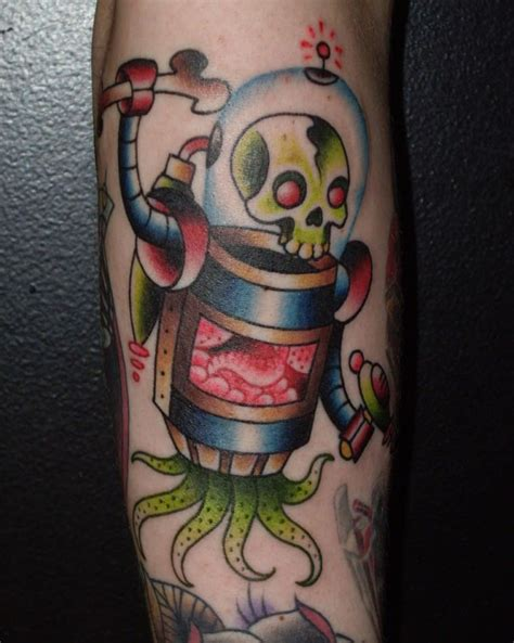 robot tattoo designs kanne uses an american traditional style to create
