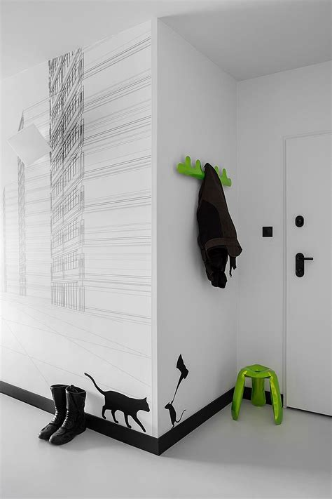 black and white wall stickers black and white wall decals and bright pops of green welcome you at the entrance of the