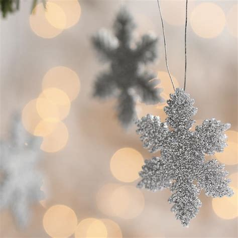 silver glitter snowflake ornaments winter weddings theme
