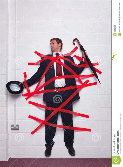stuck kleben businessman stuck to wall with royalty free stock