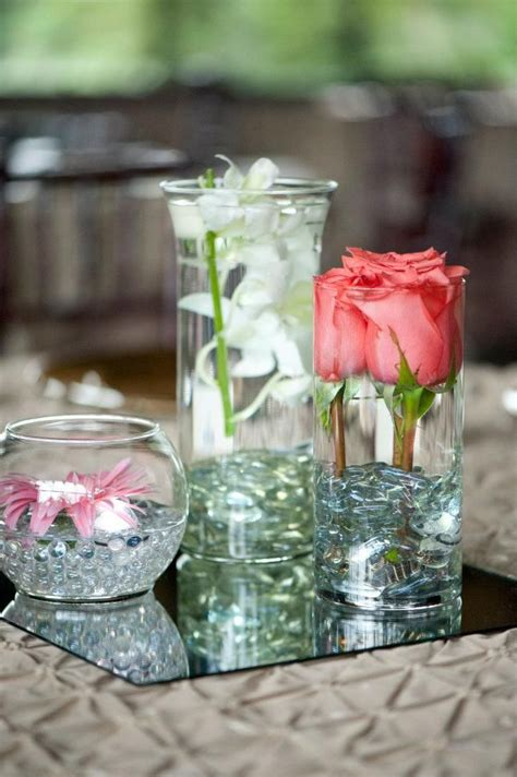 dollar store wedding centerpieces cheap diy wedding centerpieces buy different sized vases and clear stones from the dollar store