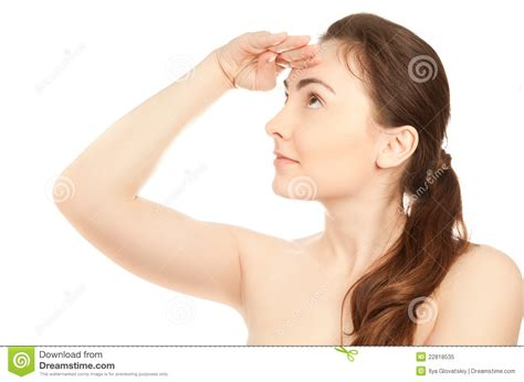 a woman looking at picture of beautiful woman looking up stock image image 22818535