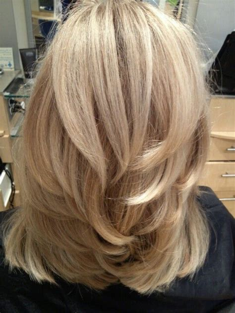 Images Of Blonde Layered Haircuts From The Back | thick straight mid length hair with chunky layers medium