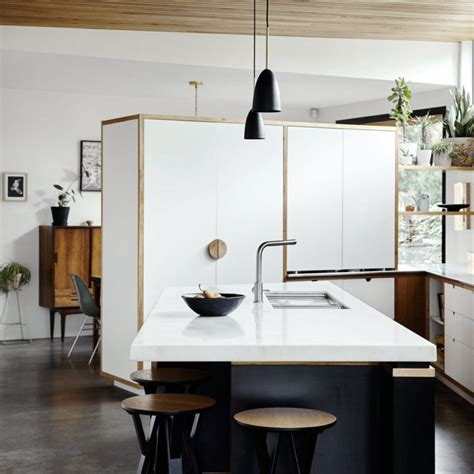the kitchen islands are done 20th century edwardian home with a concrete extension