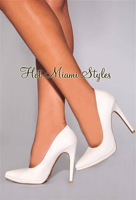 white pointed toe high heels white snake textured pointed toe high heel pumps