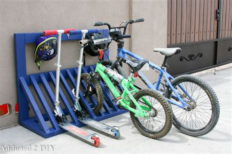 how to load bikes on bike rack simple diy kid s bicycle rack with helmet storage addicted 2 diy