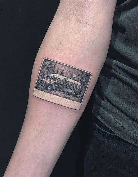 wild tattoos designs into the polaroid photo on forearm best
