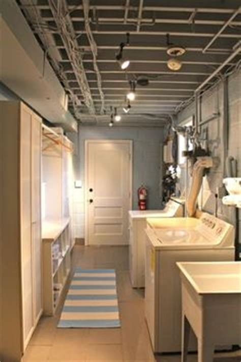basement ceiling 7 prepossessing laundry room ideas new at basement ceiling 7 thinking about converting the garage to a rec room with new laundry room rec room ideas