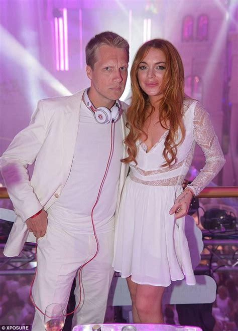 lindsay lohan undergoes a costume change from one white