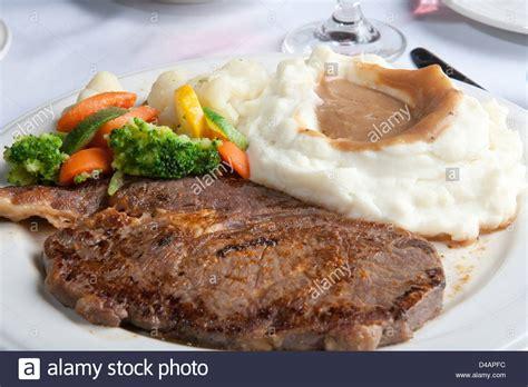 Hotplate Steak Potatoes dinner plate steak mashed potato s gravy vegetables stock photo royalty free image 54326928