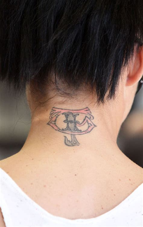 Neck Tattoo Estimate | katie price back neck tattoo picture uploaded by