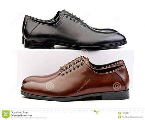 Two Pairs Of Shoes by Two Pairs Of Classic Shoes Brown And Black On Stock