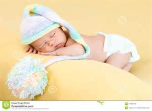 newborn baby sleeping on stomach stock