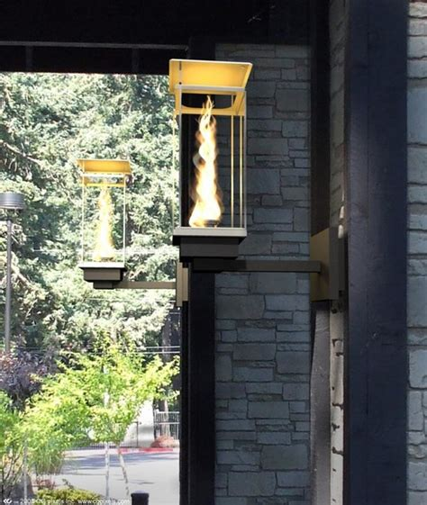 Outdoor Torch Lighting Tempest Torch Modern Outdoor Wall Lights And Sconces Seattle By Travis Industries Inc