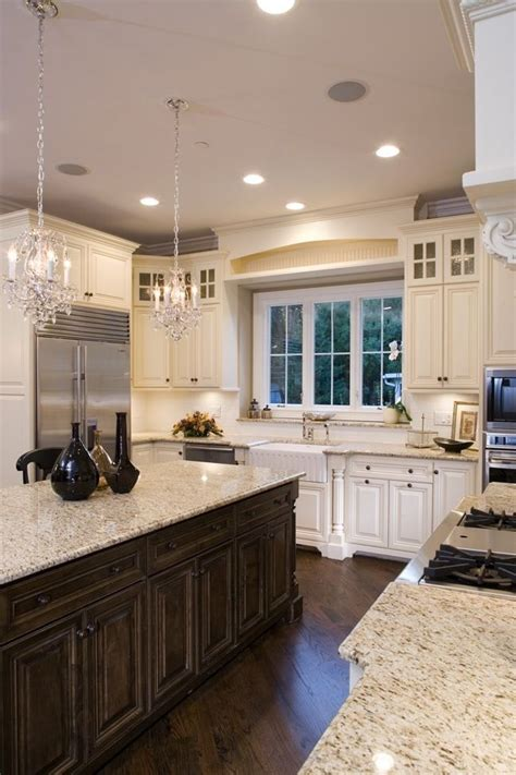 love the black cabinets and the granite countertops nice kitchen new house ideas pinterest