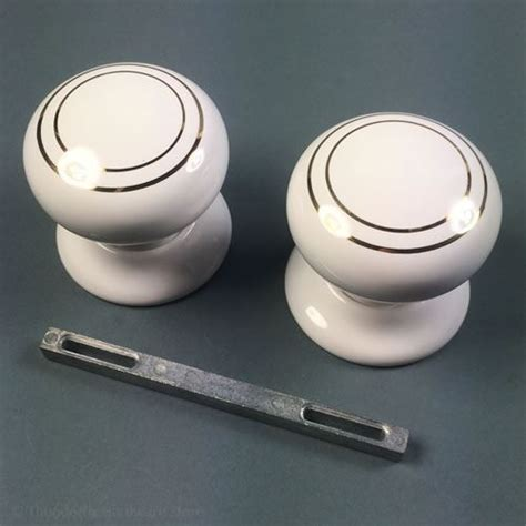 White Door Knobs Uk by Ceramic Door Knobs Handles White Glaze With Gold Rings