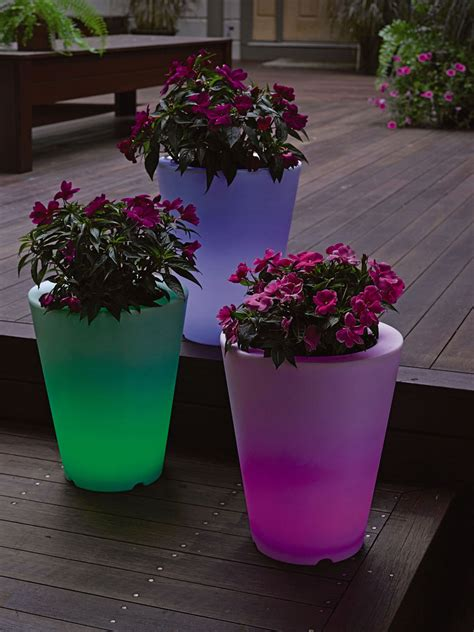solar illuminated planters 90 add an glow to