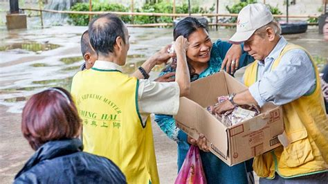 Comfort In Philippines by Providing Relief And Comfort After Typhoon Utor In The