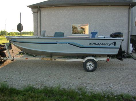 paddle boat for sale manitoba alumacraft competitor deep v with 60hp merc and trailer