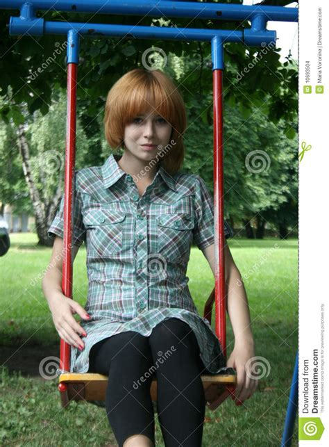sitting swing girl sitting on swing stock photo image of moving