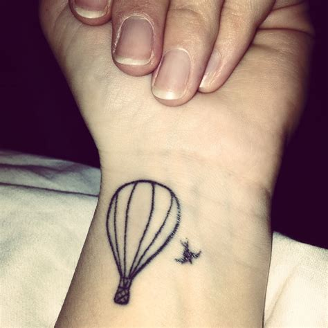 small line tattoos my of a air balloon and a