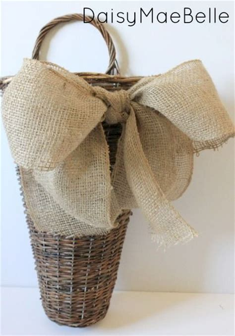 how to place burlap bow and burlap streamers on christmas tree easy burlap bow and basket burlap bows hanging baskets and 1 quot
