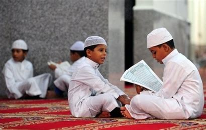 child studying koran help your children to love the holy qur an islam ru