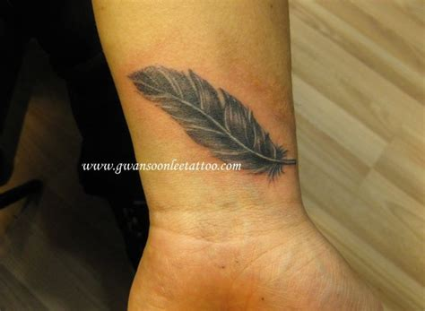 feather tattoo design on wrist tattoos pinterest