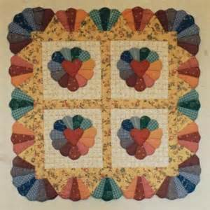 scalloped hearts and hedgerows quilted wall hanging