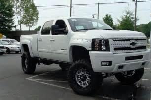 lifted white chevrolet silverado trucks