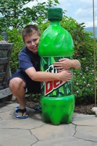 giant mountain dew bottle carved with a chainsaw neatorama