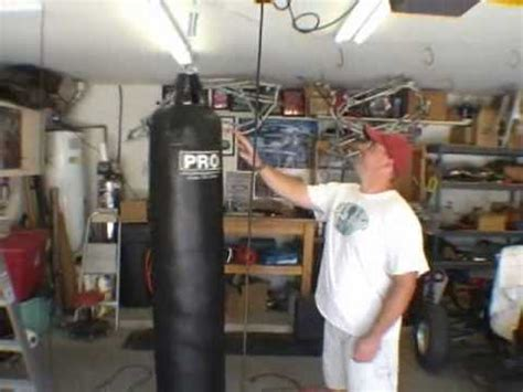 how to hang heavy things from the ceiling how to hang a muay thai heavy bag to your ceiling