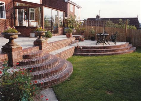 How To Build A Backyard Patio by Walls And Steps Garden Features Haywood Landscapes Ltd