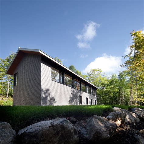 modern cottage a modern cottage on the edge of the forest design milk