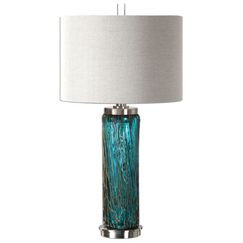 teal glass l creation of harmony within the room