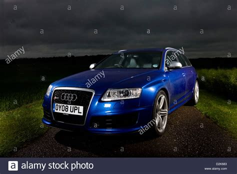 Audi Rs6 Mobile by Blue Audi Rs6 Avant Parked At On Country Road Stock