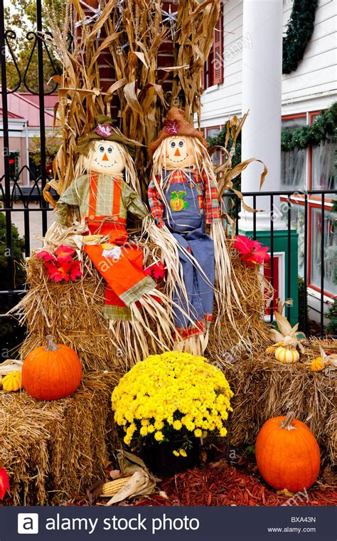 scarecrow decorations fall a display of fall decor with scarecrows pumpkins flowers